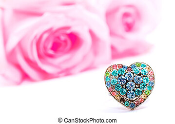 Beautiful heart-shaped ring and pink roses Shallow DOF