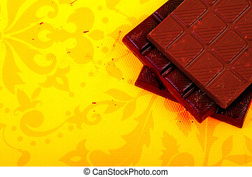 Chocolate bars on yellow background - Different chocolate...