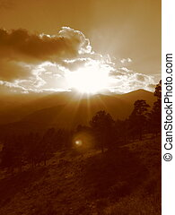 Rocky Mountain Sunset III - The sun setting behind the...