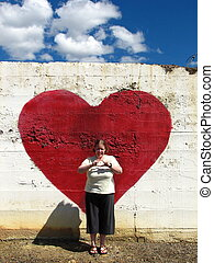 I Love You - Woman standing in front of a heart against a...