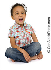 Cross Legged and Laughing - Studio shot of a beautiful mixed...
