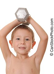 Health and Fitness Boy 10 - Young boy lifting weight that is...