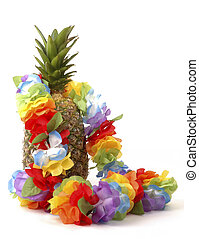 Pineapple and Lei - Colorful lei draped over a fresh...