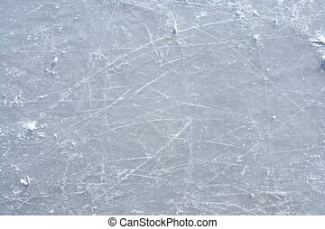 Skate marks on the surface of an outdoor ice rink - Surface...
