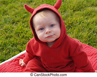 Little Devil - Eight month old child in a devil costume