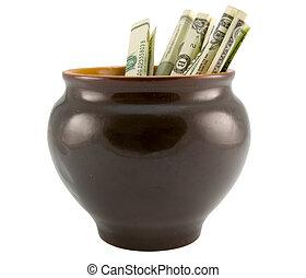 making money concept - the US dollars in ceramics pot...
