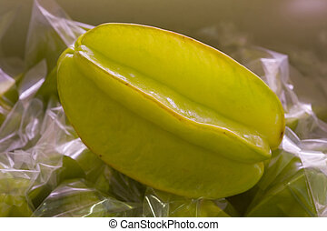 Carambola - isolated tropycal fruit carambola on a fruitshop