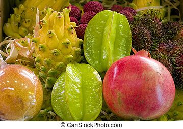 Tropycal fruits - a mix of tropycal fresh fruit in a market