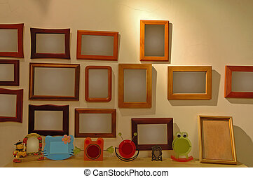 The photo frames on wall - The photo frames hanging on a...