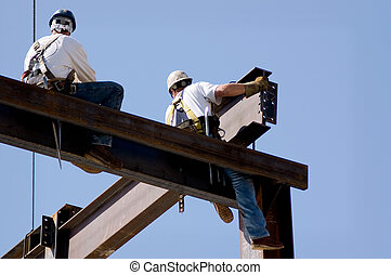 Ironworkers - Two ironworkers atop the skeleton of a modern...