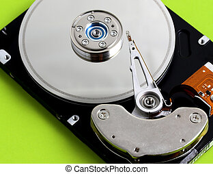 Computer hard Disk Drive - Open hard disk drive in a green...