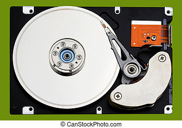 Computer hard Disk Drive - Open hard disk drive, in a green...