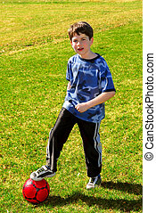 Boy with soccer ball - Young boy with a red soccer ball...
