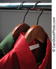 Red and green shirts in a closet - Stylish green and red...