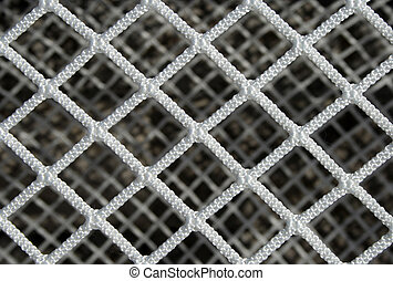 Hockey net pattern - Closeup of a new hockey goal net,...