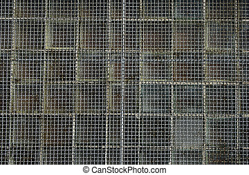 Wire mesh background - Rusty metal net covering the window.