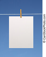 Blank paper sheet on a clothes line (+2 clipping paths)