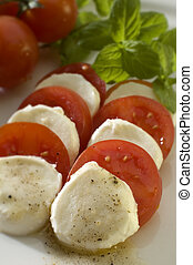 salad - mozzarella with basil, tomatoes and olive oil close...