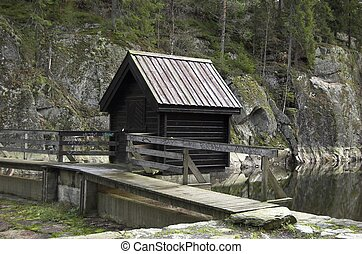 Watergate - A small house over a watergate on a lake dam.
