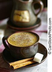Morning coffee with milk and cinnamon