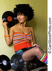 Cute curly disco girl with vinyl