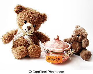 teddy bears and honey - two teddy-bears sitting near the pot...