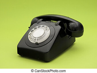 Vintage phone in a green background