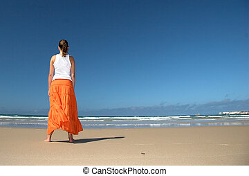 Orange skirt - Beautiful woman in the beach with a orange...