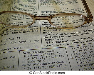 Bible with Eye Glasses on - Bible with eye glasses on top.