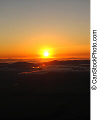 Mountain Sunrise - The sun rising across from the path up...