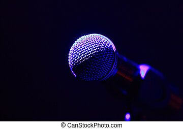 Microphone - Rock concert series: microphone, lit by purple...
