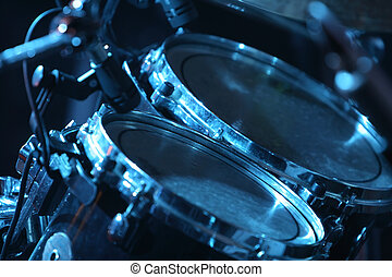 Drum set, lit by blue - Rock concert series: drum set with...
