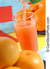 Grapefruit Juice - Grapefruit juice pouring in a glass...