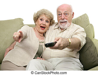 Seniors Entertained by TV - A senior couple really enjoying...