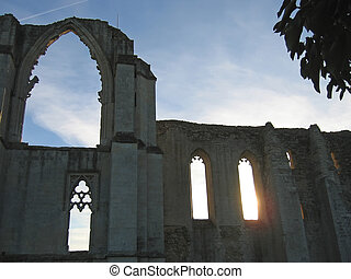 Backlighting of the Maillezais french abbey, France -...