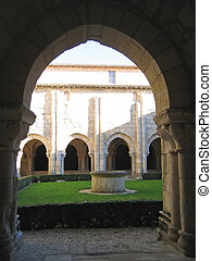 French monastic cloister with pillars in backlight, France -...