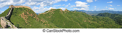 Large view of the Great Wall of China ond the mountains,...
