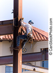 Ironmans Elevator - Young ironworker climbing a support beam...