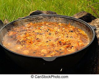 boiling pilau on the fire