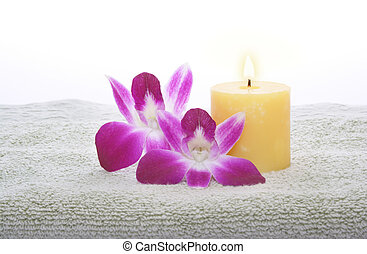 Yellow Candle and Orchid on Green Towel