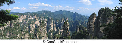 Pattern of high rocks emerging from the jungle, Zhengjiajie national park, China, Panorama