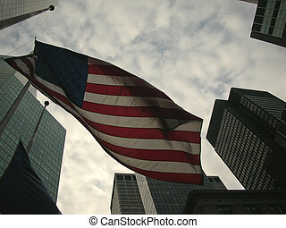 US Flag around building tower, New York - US Flag around...