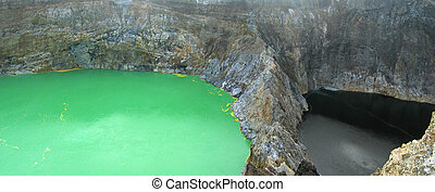 The green crater lake and the black one, Kelimutu volcano,...