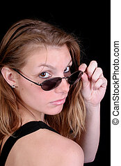 Cute woman sunglasses - A cute woman is looking over her...