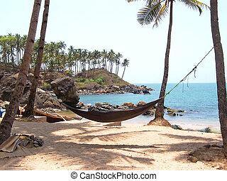 Tropical beach with hammock, Goa, India - Tropical beach...