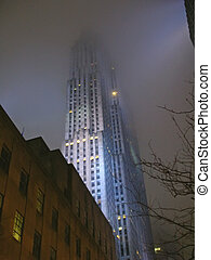 Very high tower by night with blue colors, New York - Very...