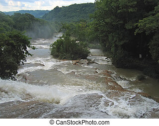 Waterfalls with the river and the tropical jungle, Agua...