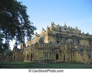 Yellow sacred budhist temple in Inwa, Mandalay, Myanmar -...