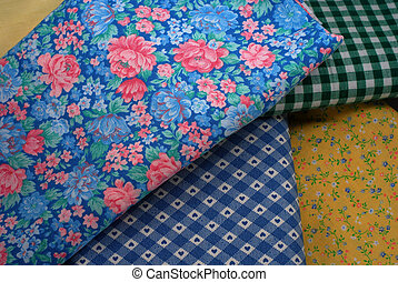 Bolts Of Fabric - Bolts of fabric with various print...