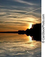 summer sunset by a lake - beautiful summer sunset reflected...